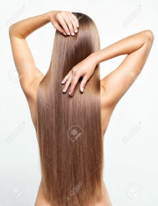 15719219-Portrait-of-beautiful-young-woman-with-long-healthy-hair-Stock-Photo